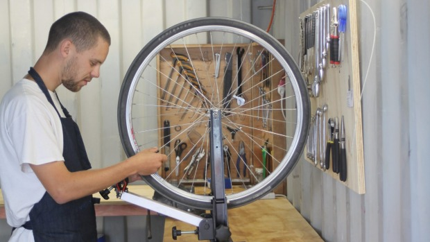 The space is equipped with tools and machines to help with bike problems such as recabling brakes, and adjusting gears and wheels.